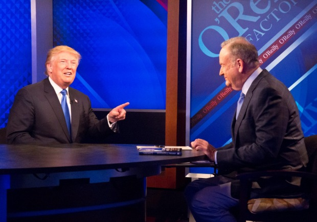Republican presidential candidate Donald Trump, left, speaks during his interview by Bill O'Reilly on Fox's news talk ...