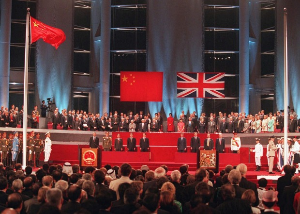 World dignitaries and other guests at the Handover ceremomy at the Hong Kong Convention Centre watch the Chinese flag  ...