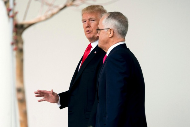 President Donald Trump and Australian Prime Minister Malcolm Turnbull walk along the Colonnade as Turnbull arrives at ...