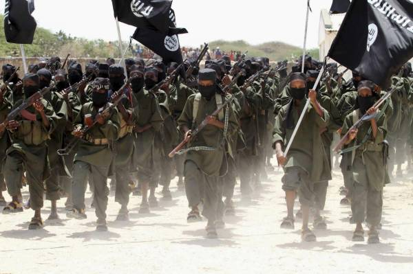 File photo of new recruits belonging to the al Shabaab militant group marching during a passing out parade at a military training base in Afgoye