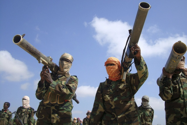 Members of the hardline al Shabaab Islamist rebel group hold their weapons in Somalia's capital Mogadishu