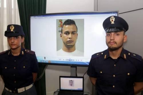 Poliziotti e Abdelmajid Touid 500