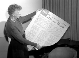 Mrs. Eleanor Roosevelt of the United States holding a Declaration of Human Rights poster. November 1949