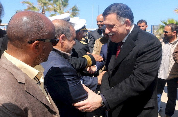 Libyan Prime Minister-designate Fayez Seraj (R) is greeted upon arrival in Tripoli, Libya March 30, 2016. REUTERS/Hani Amara - RTSCV7R