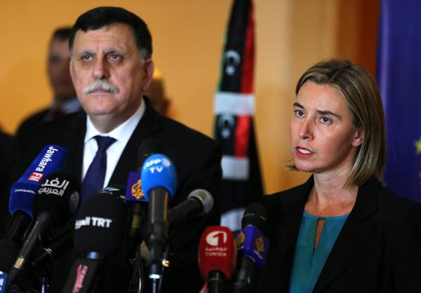 epa05092861 High Representative of the European Union for Foreign Affairs and Security Policy Federica Mogherini (R) speaks during a press conference with Libyan Prime Minister Fayez Sarraj (L) after their meeting in Tunis, Tunisia, 08 January 2016. Mogherini is meeting in Tunis with Sarraj and members of the Libyan Presidency Council to discuss ways to support Libya after signing a peace agreement among warring factions in the country. EPA/MOHAMED MESSARA