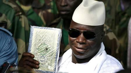 Yahya Jimme con in mano il Corano