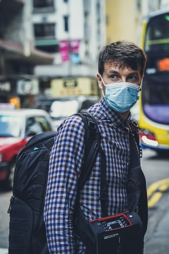 Traveler with face mask