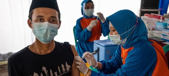 A COVID-19 vaccine is administered in Kediri, East Java, Indonesia.