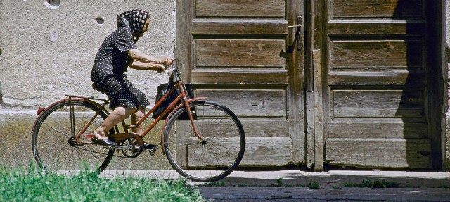 An elderly woman rides her bike in Croatia (13 February 2013). New World Health Organization (WHO) guidelines stress the value of regular exercise to prevent the onset of dementia.