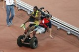 Beijing Controversy: Cameraman Almost Breaks Usain Bolt's Legs, Guard Tries to Steal His Spikes
