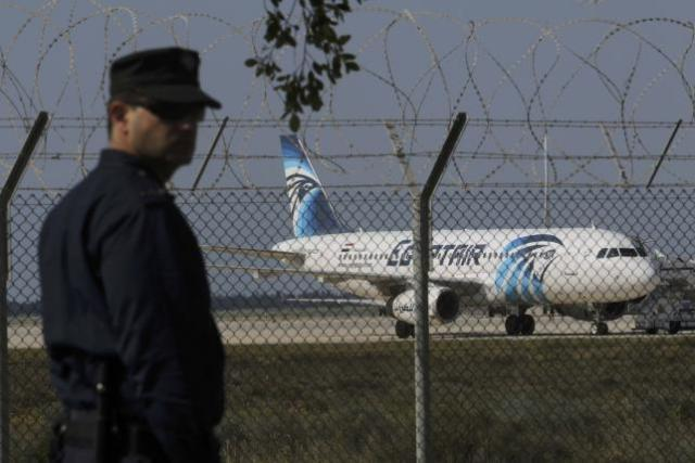 A policeman stands guard at Larnaca Airport near a hijacked Egypt Air A320
