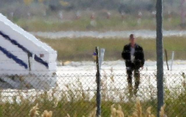 A man thought to be the hijacker leaves the hijacked Egyptair Airbus A320 at Larnaca Airport in Larnaca, Cyprus