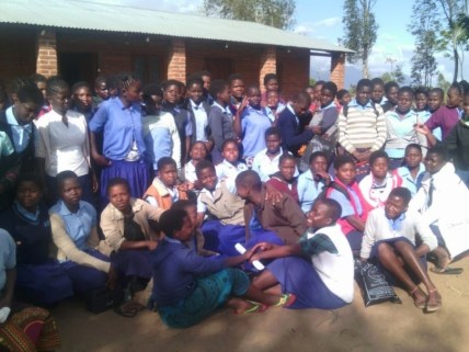 Participants to the second Girl Shower at Namphungo Community Day Secondary School pose for a group photograph during the shower