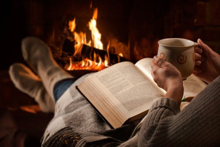 Reading a book by the fire