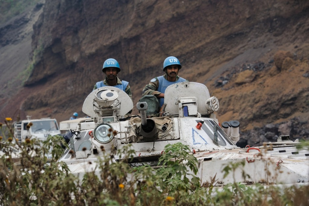 Indian peacekeepers sit atop a BMP in Monigi on the outskirts of Goma in the east of the Democratic Republic of the Congo on July 19, 2013. The UN has been supporting the Congolese army with logistical support, and forming a rear-line as the FARDC battle M23 rebels. [PHIL MOORE]