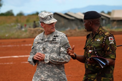 Command Sgt. Major Mark Ripka, US Africa Command, and Warrant Officer class 1 J. Amithiko, Kenya, talk on the parade field for Natural Fire 10 Distinguished Visitors Day, Kitgum, Uganda. US ARMY Africa