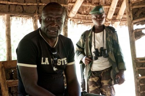 'Colonel' James, APCLS second in command, at the group's military base in Lukweti. Behind him, his 'Chief Escort', who is called Sentiment. Masisi territory, August 2013. ALEXIS BOUVY/Local Voices