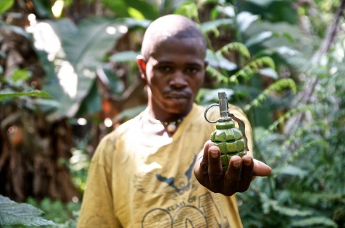 An APCLS militiaman walks in the forest with a grenade as his only weapon. Lukweti, August 2013. ALEXIS BOUVY/ Local Voices