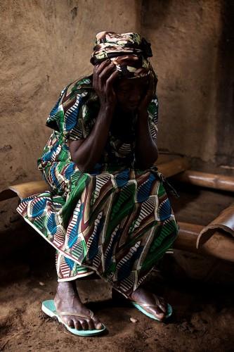 In Lukweti, an elderly lady prays in church during Mass on Sunday. Lukweti, August 2013. ALEXIS BOUVY/ Local Voices