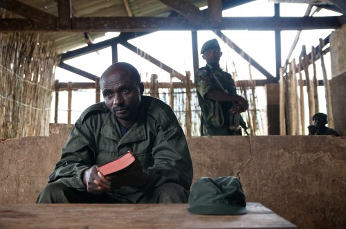 'General' Janvier Karairi, the APCLS commander, with his Bible in his hands, in a school in ruins in Kinyumba. Masisi territory, August 2013. ALEXIS BOUVY/Local Voices