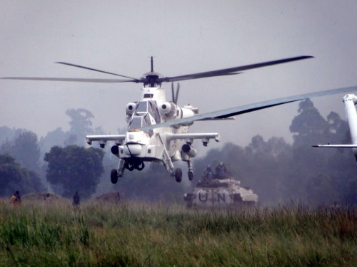 The Photo is showing MONUSCO's Attack Helicopter providing aerial and ground protection of a convoy carrying FDLR Ex–Combatants on their de- induction from Kanyabayonga transit camp. Photo by MONUSCO