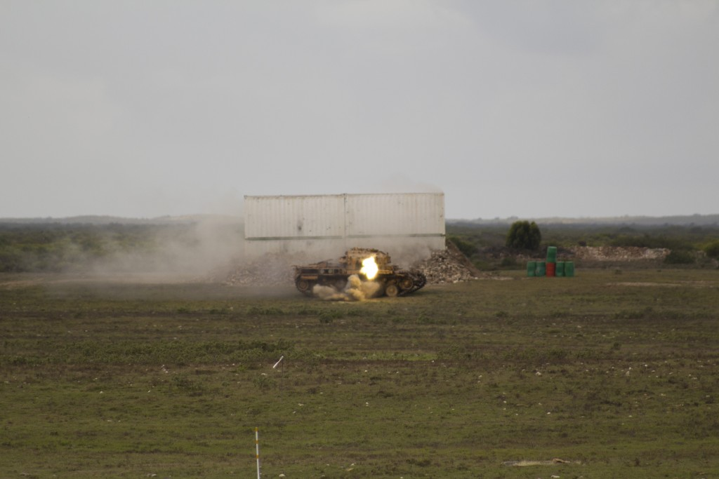 Rheinmetall Denel Defence Day - An obsolete tank used as a target is hit with 20mm rounds from a SAAF Rooivalk attack helicopter. ADR/JOHN STUPART