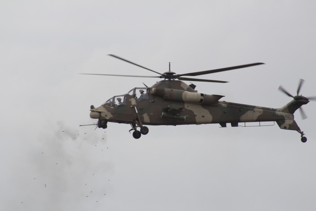 Rheinmetall Denel Defence Day - A Rooivalk Attack Helicopter engages a target with its 20mm cannon. ADR/JOHN STUPART