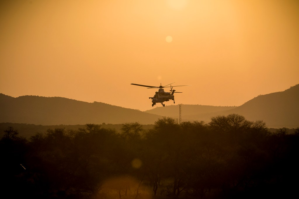 A SAAF Rooivalk CSH provides overhead support. Photo by Trent Perkins/ADR
