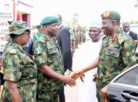 Jonathan in handshake with Army Chief, Gen. Ihejirika