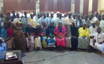 Participants at the discussion roundtable in a group picture shortly after the event