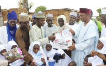 Student's of Shara community's under-tree school receiving sets of uniforms and learning materials donated to them by CITAD