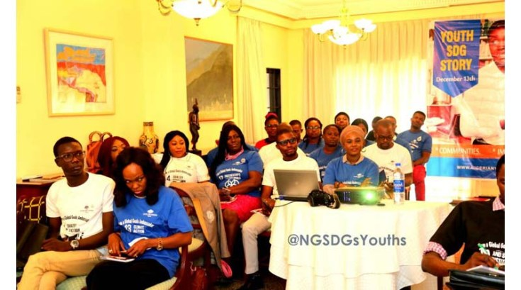 A cross-section of youth participants, listening to SDG action stories at the event