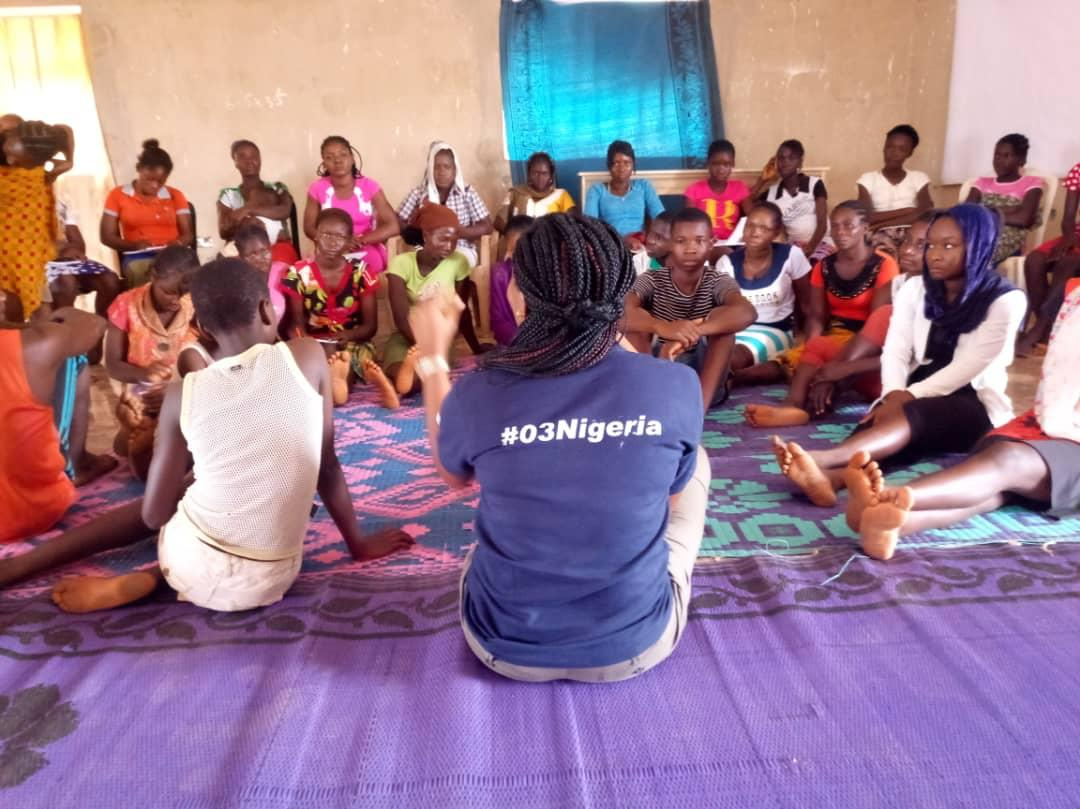 Linda Raji and other members of the SEGEI team counselling out-of-school girls