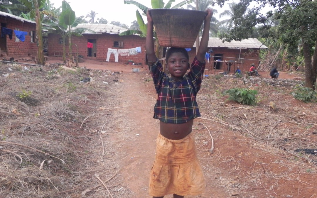 Boy carrying water in Cameroon