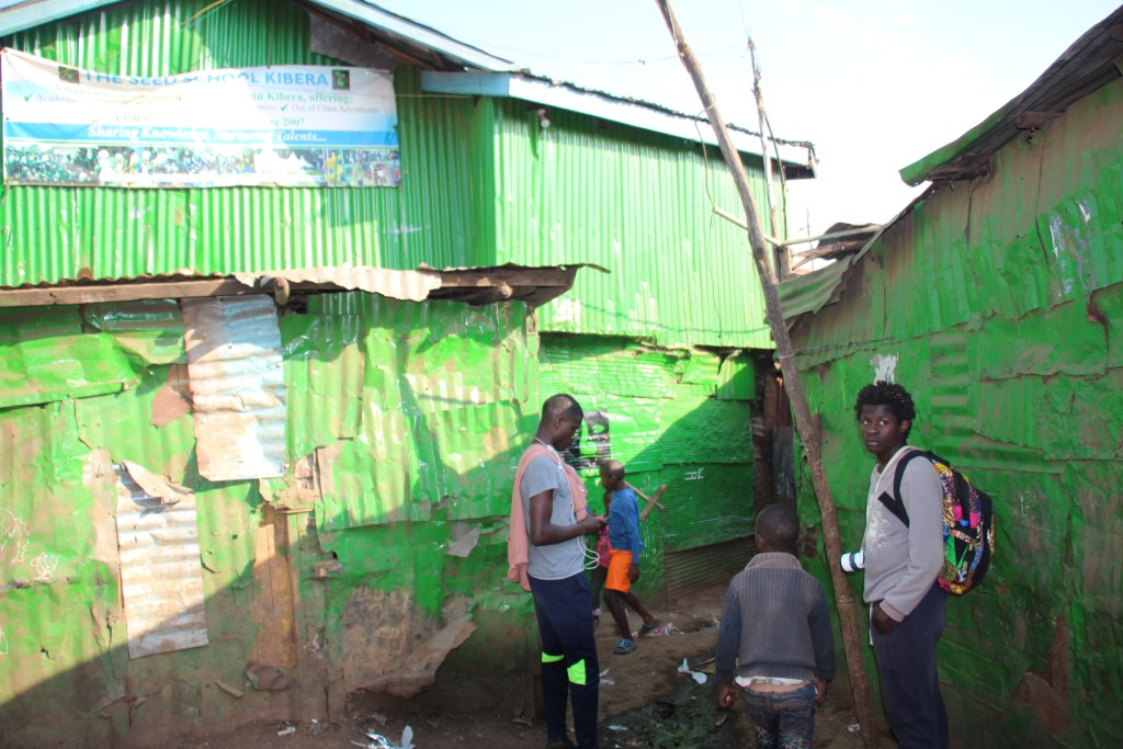 a group of people in the Kibera slum in Kenya