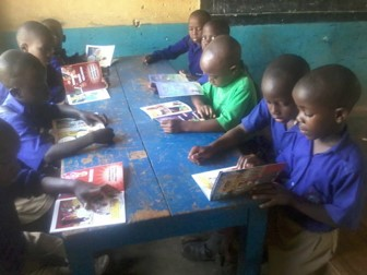 Students using new textbooks in Uganda
