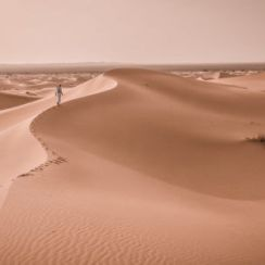 Tuareg walking on the soil desert