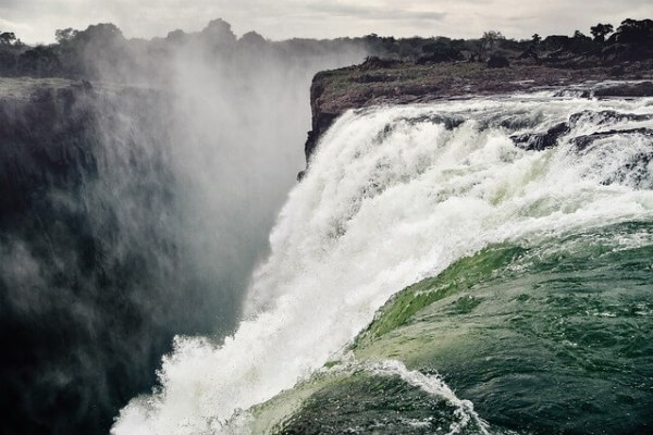 The Victoria Falls, one of the largest falls in the world, is located on the Zambezi River on the border between Zambia and Zimbabwe
