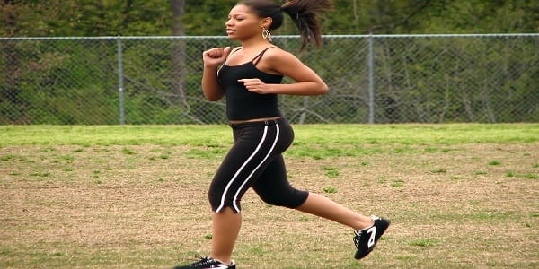 5166-a-beautiful-teen-african-american-girl-running-by-a-fence-pv