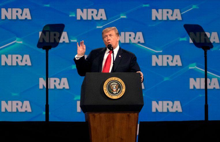Cell phone thrower misses Trump at NRA meeting