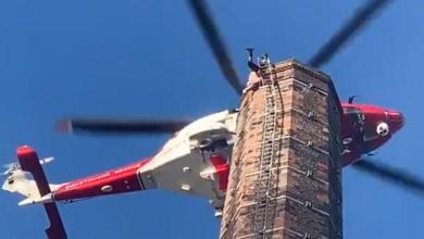 Photo of Man died after dangling for hours upside down at a 90m high chimney