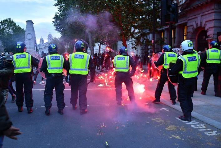 Protesters and police clash in London.
