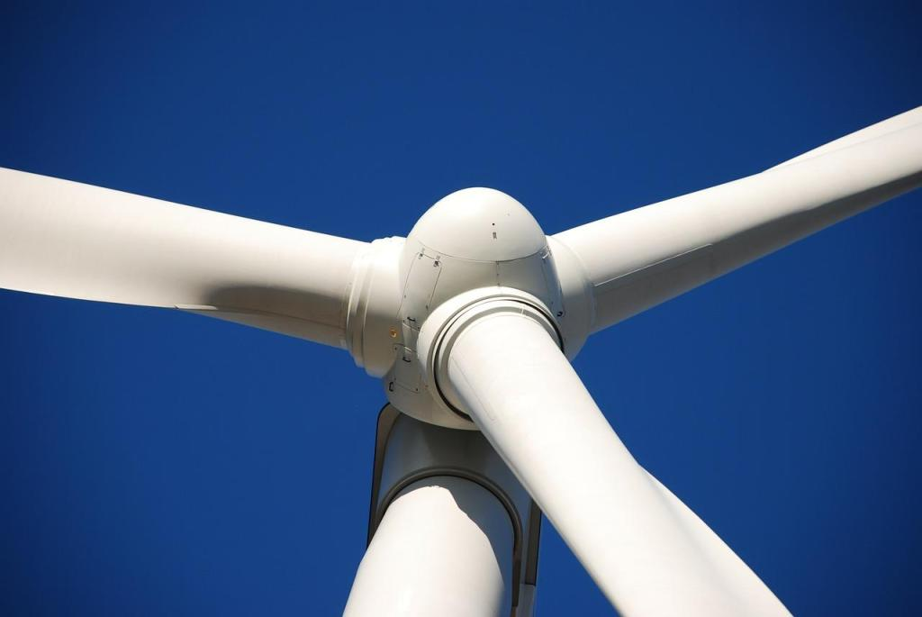 Why do wind turbines have 3 blades? And why do they turn clockwise?