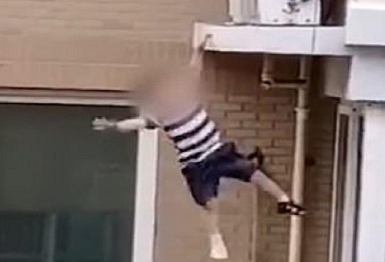 Neighbor catches boy (2) who falls down from fifth floors