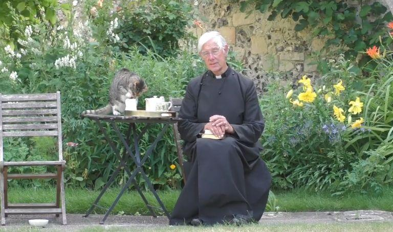 While Priest is preaching, cat is seriously lapping his milk [video]
