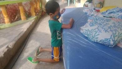 Photo of Boy (9), tested positive to Covid-19 cries and praying to God