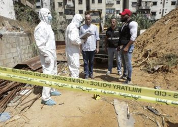 This picture taken on August 25, 2019 shows forensic investigators of Lebanon's military intelligence inspecting the scene where two drones came down in the vicinity of a media centre of the Shiite Hezbollah movement earlier in the day in the south of the capital Beirut. – Hezbollah said on August 25 that one of the drones was rigged with explosives and caused damage to its media centre, but denied shooting down any of them. The early morning incident came hours after Israel launched air strikes in neighbouring Syria, but Hezbollah officials could not confirm if the drones deployed in Lebanon were Israeli. Another Hezbollah source told AFP the Iran-backed Shiite militant group — a major political player in Lebanon with representatives in parliament and the government — has not determined if the drones were Israeli. (Photo by ANWAR AMRO / AFP)