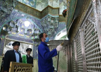Iranian sanitary workers disinfect Qom's Masumeh shrine on February 25, 2020 to prevent the spread of the coronavirus which reached Iran, where there were concerns the situation might be worse than officially acknowledged. - The deaths from the disease -- officially known as COVID-19 -- in the Islamic republic were the first in the Middle East and the country's toll with so far a dozen people officially reported dead, is now the highest outside mainland China, the epidemic's epicentre. (Photo by MEHDI MARIZAD / FARS NEWS AGENCY / AFP)