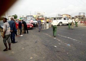 Police and other security officials ensuring that only vehicles on essential services leave Lagos to other states from the Ojodu Berger axis. Photo: Victor Gbonegun.