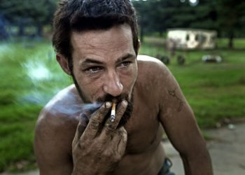 Lukas Gouws, 29, smokes at a squatter camp for poor white South Africans at Coronation Park in Krugersdorp, March 6, 2010. A shift in racial hiring practices and the recent global economic crisis means many white South Africans have fallen on hard times. Researchers now estimate some 450,000 whites, of a total white population of 4.5 million, live below the poverty line and 100,000 are struggling just to survive in places such as Coronation Park, a former caravan camp currently home to more than 400 white squatters. Picture taken March 6, 2010. To match feature SAFRICA-WHITES/ REUTERS/Finbarr O'Reilly